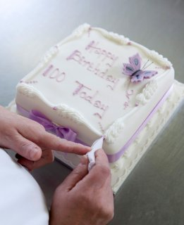 Hand written cake being hand finished